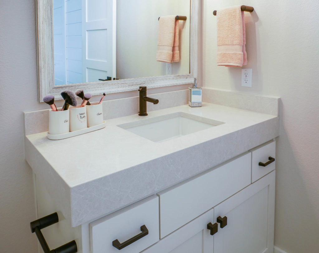 quartz bathroom countertop with traditional backsplashes